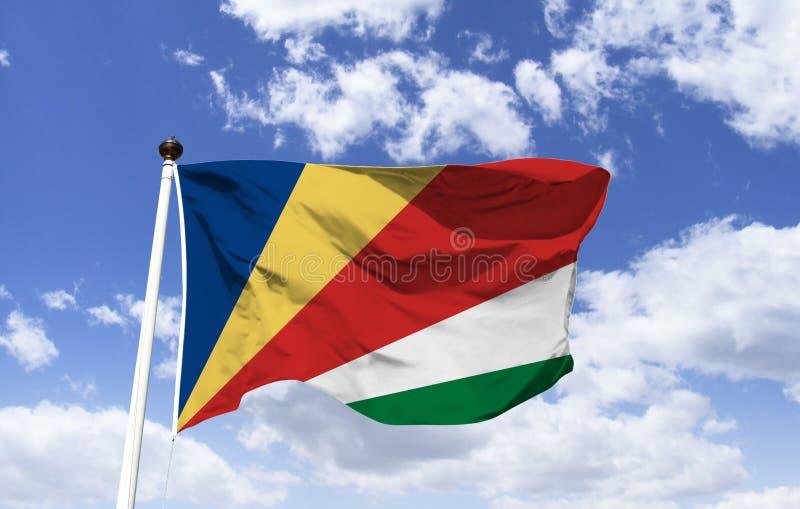 Πρότυπο σημαιών των Σεϋχελλών που επιπλέει κάτω από έναν μπλε ουρανό απεικόνιση αποθεμάτων