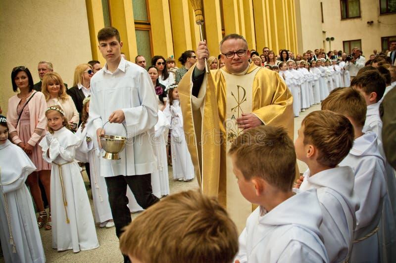 Πρώτη ιερή τελετή κοινωνίας στο Πόζναν Πολωνία 2017 στοκ εικόνα