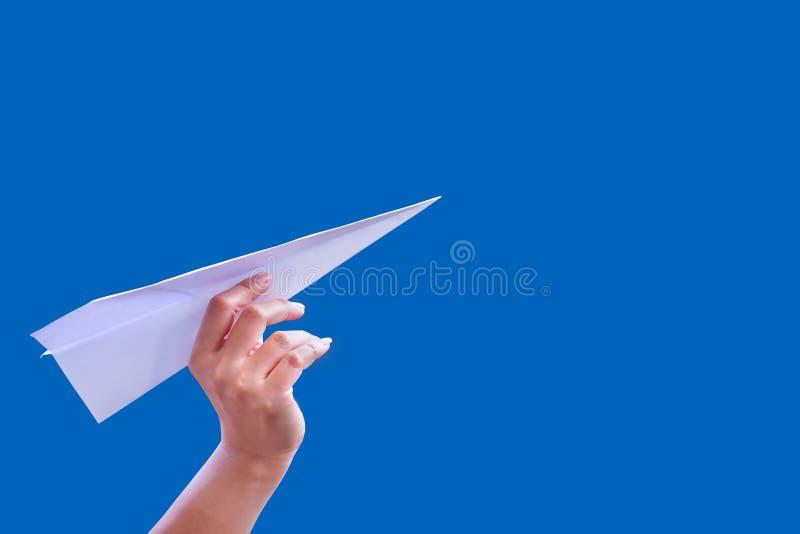 Πτυχές εγγράφου αεροσκαφών χεριών στην επιτυχία για το έγγραφο πυραύλων σχεδίου στοκ φωτογραφία