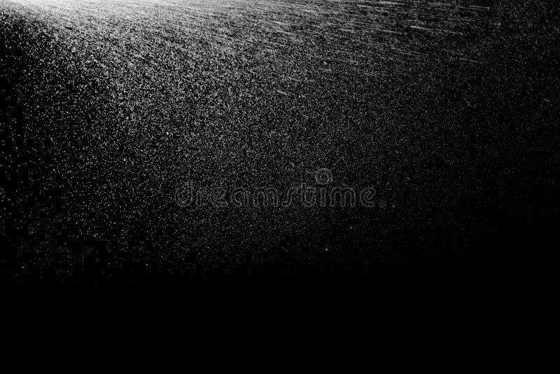 Πτώσεις ψεκασμού στο μαύρο υπόβαθρο στοκ εικόνα με δικαίωμα ελεύθερης χρήσης