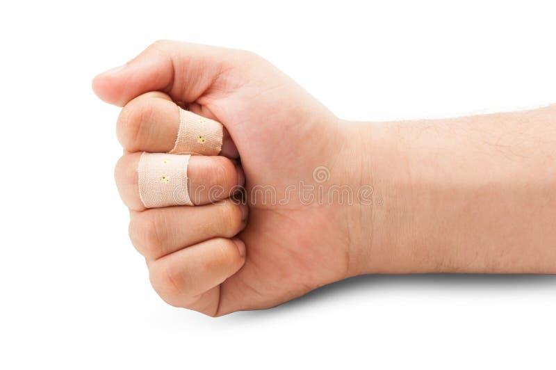 Πυγμή με τα πληγωμένα δάχτυλα στοκ εικόνες