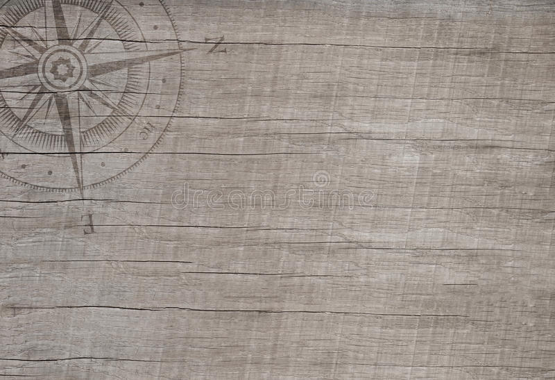 Πυξίδα στο ξύλινο υπόβαθρο για την έννοια ταξιδιού. στοκ εικόνες
