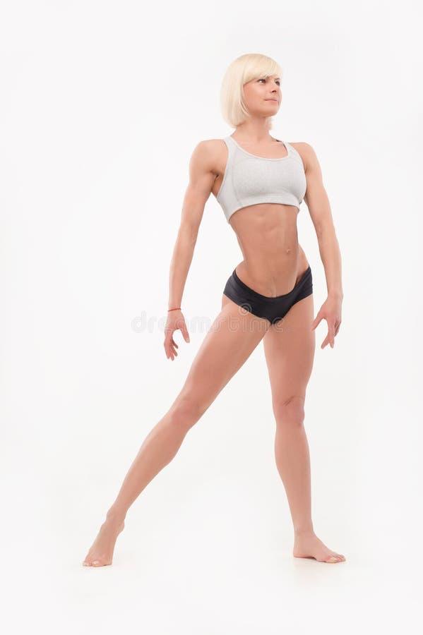 Πυροβοληθείς των θηλυκών αθλητικών μορφών στοκ εικόνες