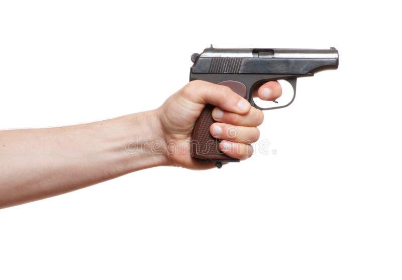 Πυροβόλο όπλο στο ανθρώπινο χέρι στοκ εικόνες
