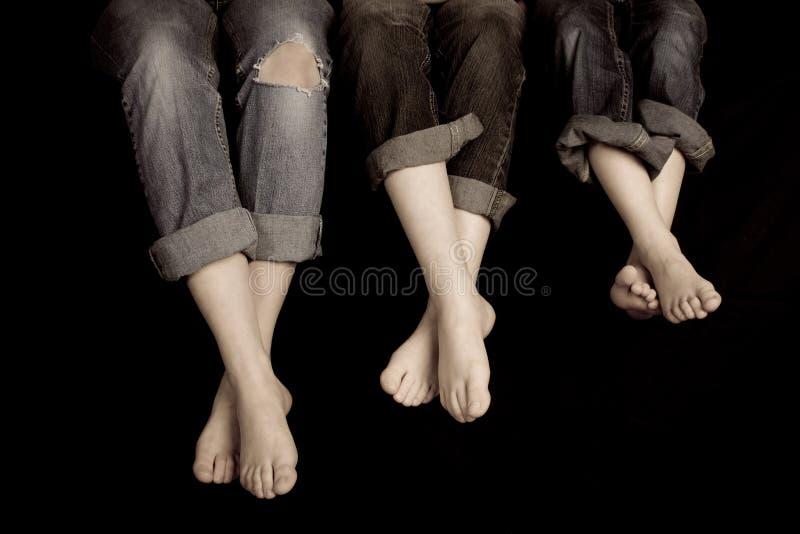 πόδια ζευγαριών τρία στοκ εικόνες