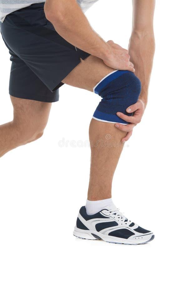 Πόνος σε ένα γόνατο. στοκ φωτογραφία
