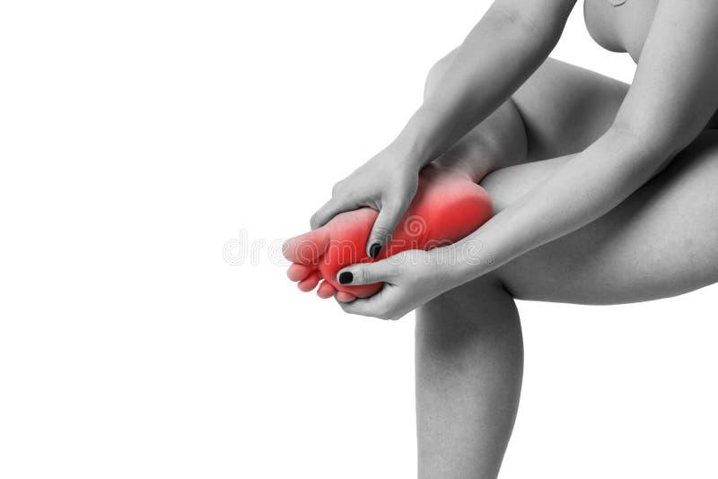 Πόνος στα πόδια γυναικών ` s, μασάζ των θηλυκών ποδιών που απομονώνεται στο άσπρο υπόβαθρο στοκ εικόνες