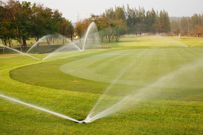 πότισμα γκολφ σειράς μαθημάτων στοκ φωτογραφίες