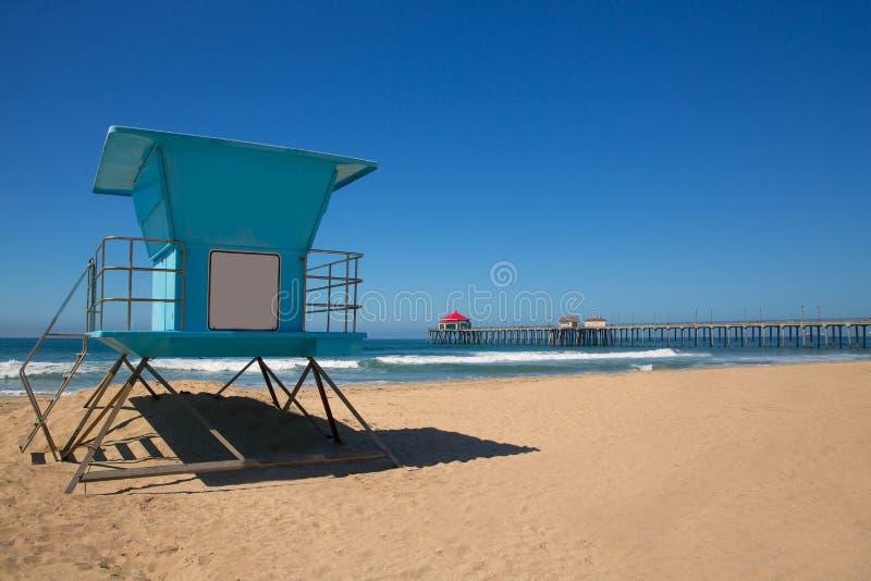 Πόλη ΗΠΑ κυματωγών αποβαθρών παραλιών Huntington με τον πύργο lifeguard στοκ εικόνα