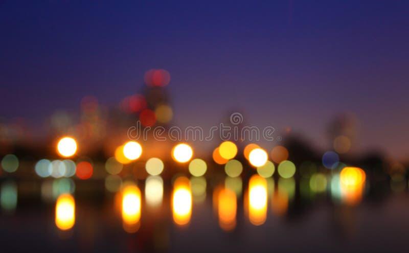 Πόλη τη νύχτα - φωτογραφία θαμπάδων, υπόβαθρο Bokeh στοκ εικόνα