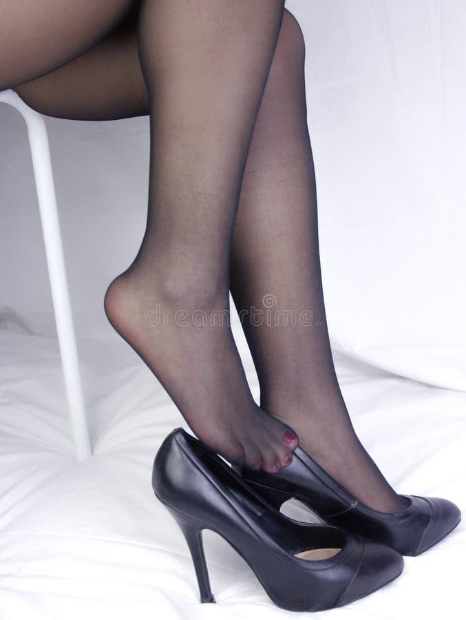 Πόδια και παπούτσια στοκ εικόνα