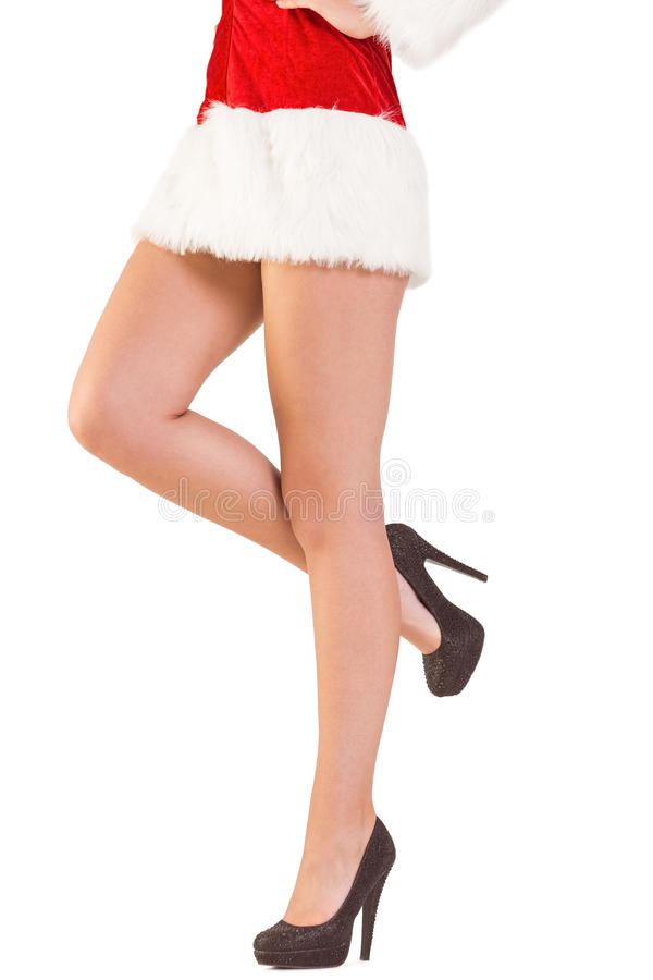 Πόδια της εορταστικής γυναίκας στα υψηλά τακούνια στοκ φωτογραφία με δικαίωμα ελεύθερης χρήσης