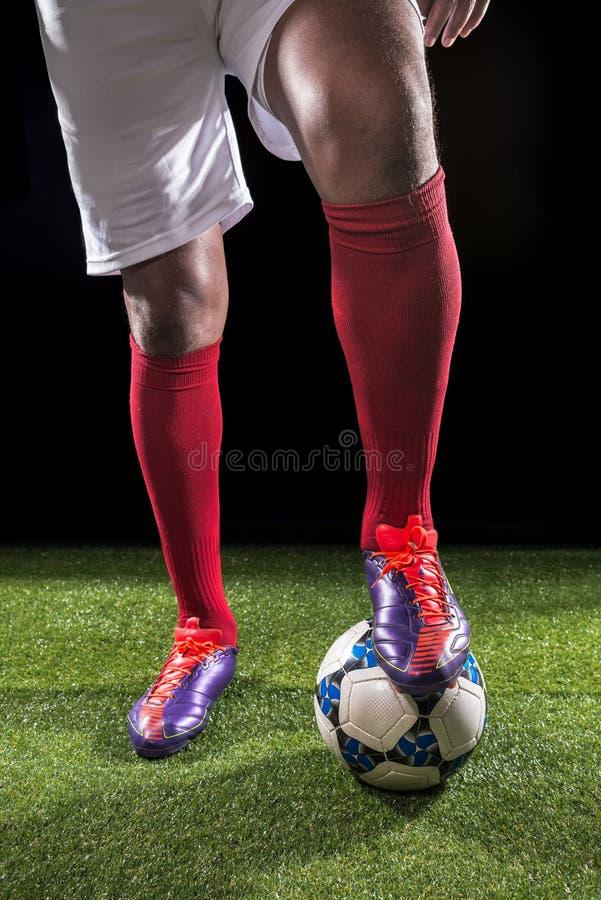 Πόδια του ποδοσφαιριστή στοκ φωτογραφία με δικαίωμα ελεύθερης χρήσης