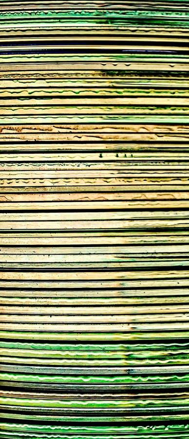 Πλάγια όψη μιας δέσμης των CD στοκ εικόνα