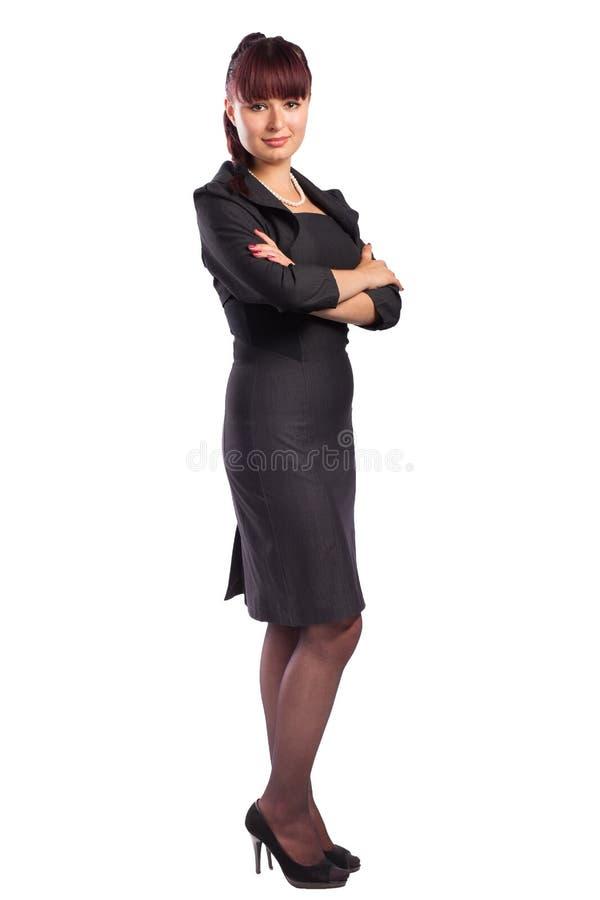 Πλήρες μήκος της όμορφης στάσης επιχειρησιακών γυναικών με τα όπλα folde στοκ εικόνες