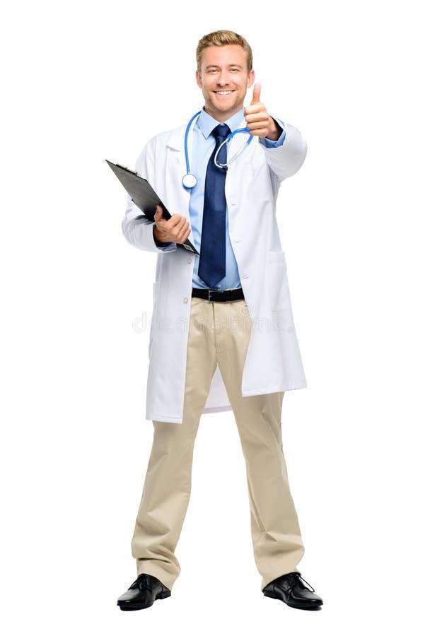 Πλήρες μήκος του βέβαιου νέου γιατρού στο άσπρο υπόβαθρο στοκ φωτογραφία