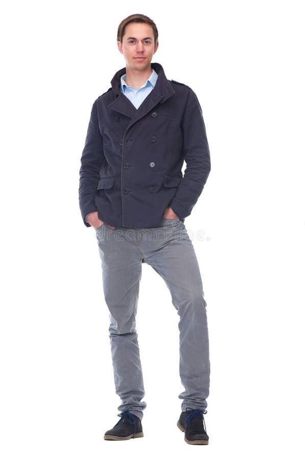 Πλήρες πορτρέτο σωμάτων ενός καθιερώνοντος τη μόδα νεαρού άνδρα στη μπλε ζακέτα στοκ φωτογραφίες με δικαίωμα ελεύθερης χρήσης