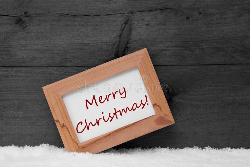 Πλαίσιο εικόνων με το γκρίζο υπόβαθρο, Χαρούμενα Χριστούγεννα, χιόνι στοκ εικόνα