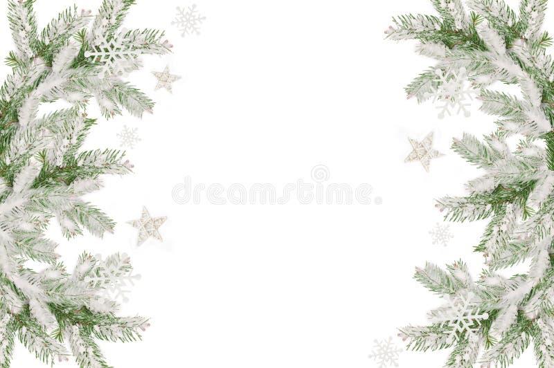 Πλαίσιο Χριστουγέννων των χιονισμένων κλάδων και της θέσης έλατου για το κείμενο απεικόνιση αποθεμάτων