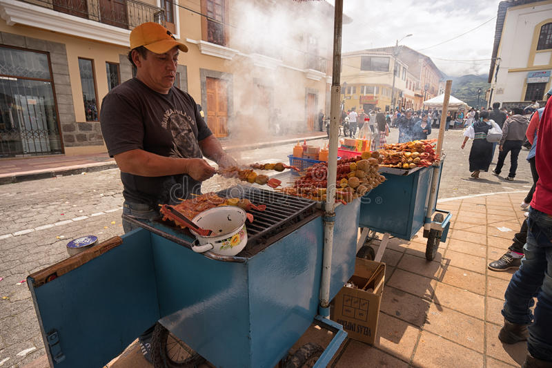 Πλανόδιος πωλητής που προετοιμάζει τα τρόφιμα στοκ εικόνα με δικαίωμα ελεύθερης χρήσης