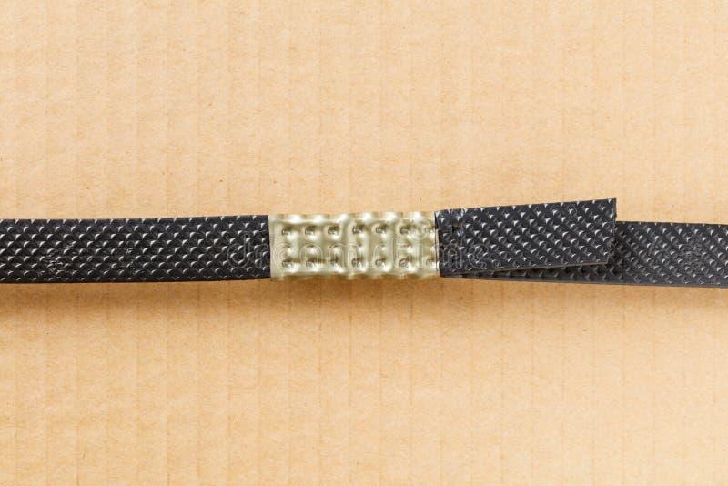 Πλαστικό πολυ λουρί με το σφιγκτήρα μετάλλων στοκ εικόνες με δικαίωμα ελεύθερης χρήσης