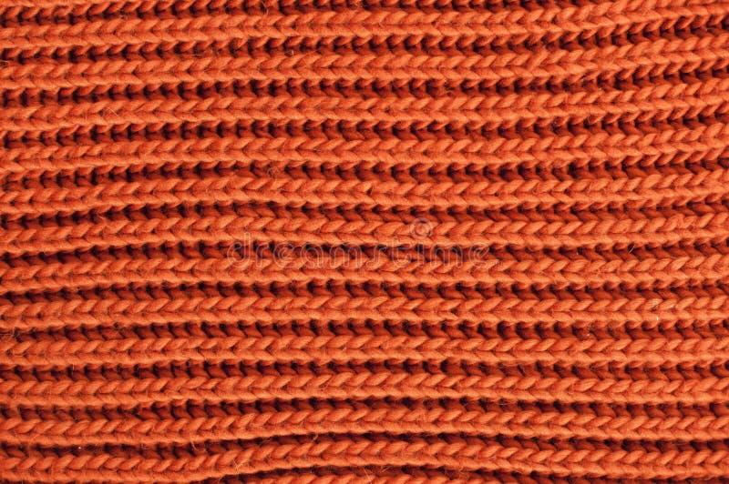 Πλεκτή πορτοκάλι σύσταση Νήμα μαλλιού στο πλέξιμο του υποβάθρου στοκ εικόνες