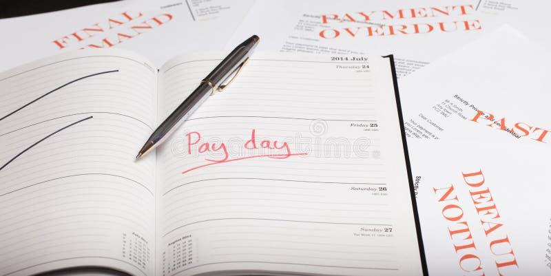 Πληρώστε το δάνειο ημέρας στοκ φωτογραφία με δικαίωμα ελεύθερης χρήσης