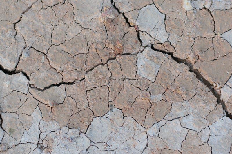 Ραγισμένη επίγεια ξηρασία στοκ εικόνα