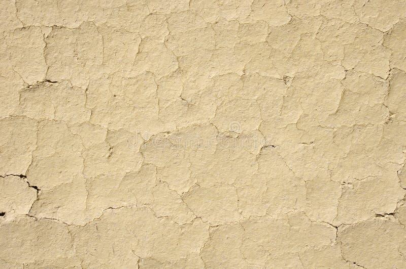 Ραγισμένη κινηματογράφηση σε πρώτο πλάνο τοίχων ασβεστοκονιάματος λάσπης στοκ φωτογραφίες