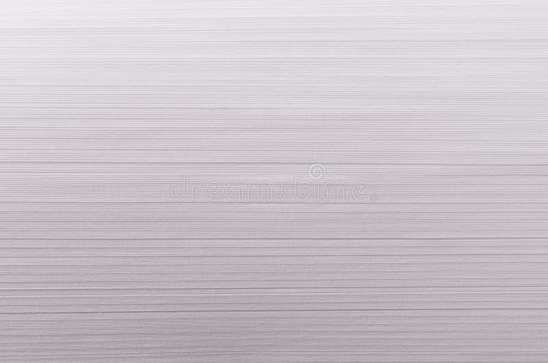 Ριγωτή ομαλή μαλακή άσπρη σύσταση με τις λεπτές παράλληλες ραβδώσεις στοκ φωτογραφία με δικαίωμα ελεύθερης χρήσης