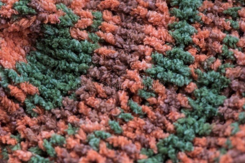 Ριγωτοί καφετής, πράσινος και το πορτοκάλι πλέκει τη σύσταση υφάσματος, πλεκτό PA στοκ εικόνες