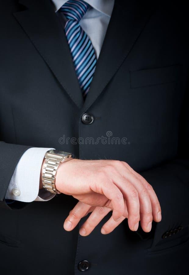 ρολόι επιχειρηματιών η πρ&omicron στοκ εικόνα με δικαίωμα ελεύθερης χρήσης