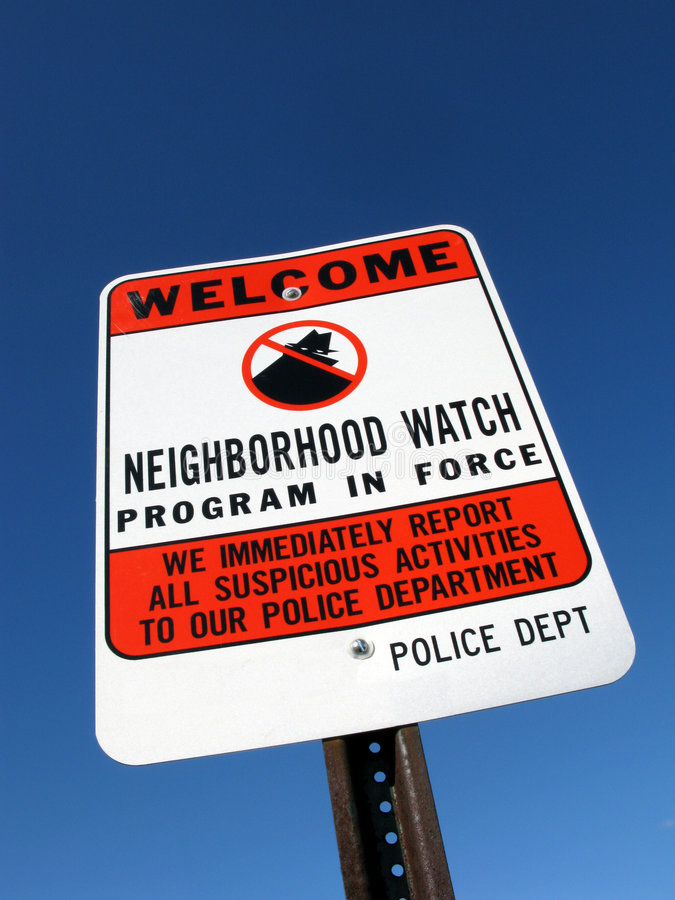 ρολόι σημαδιών γειτονιάς εγκλήματος στοκ φωτογραφία