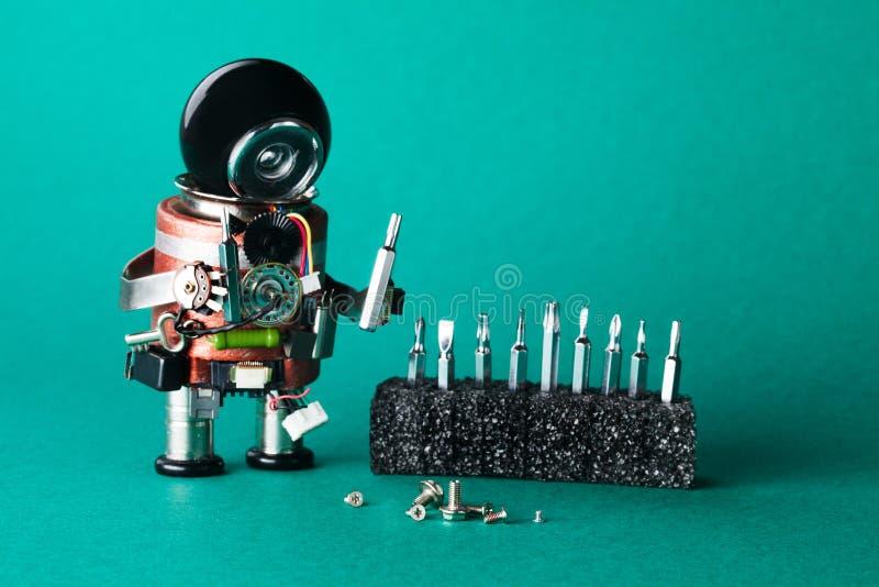 Ρομπότ handyman με τις διαφορετικές βίδες μεγέθους Έννοια υπηρεσιών συντήρησης Δημιουργικός χαρακτήρας παιχνιδιών σχεδίου ρομποτι στοκ εικόνα