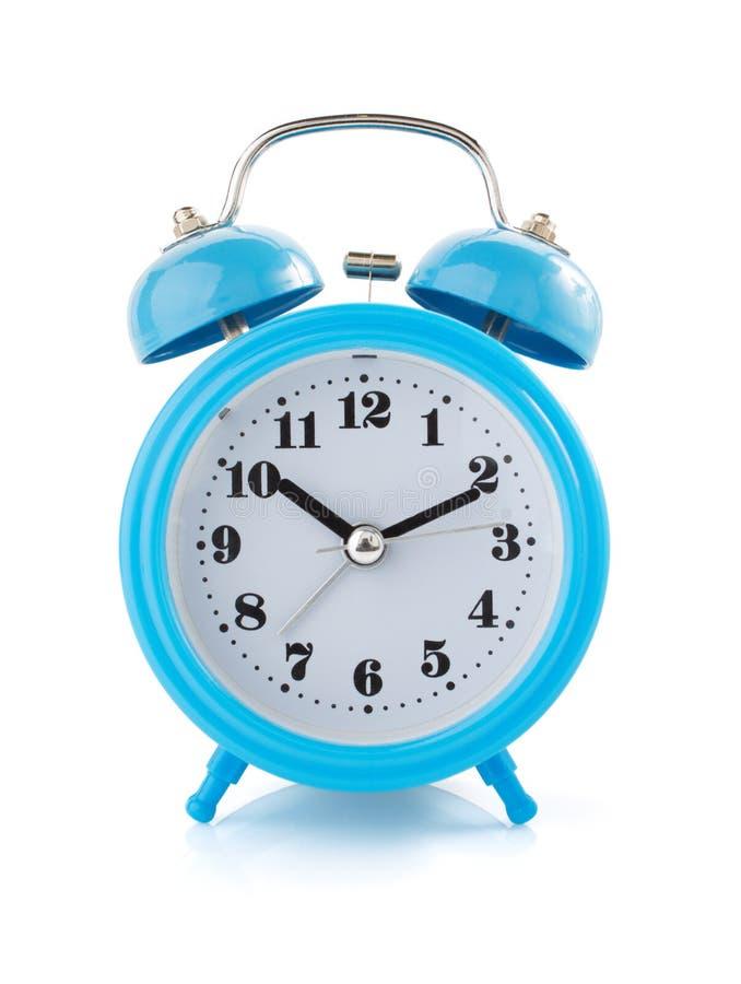 Ρολόι ξυπνητηριών στο άσπρο υπόβαθρο στοκ φωτογραφίες