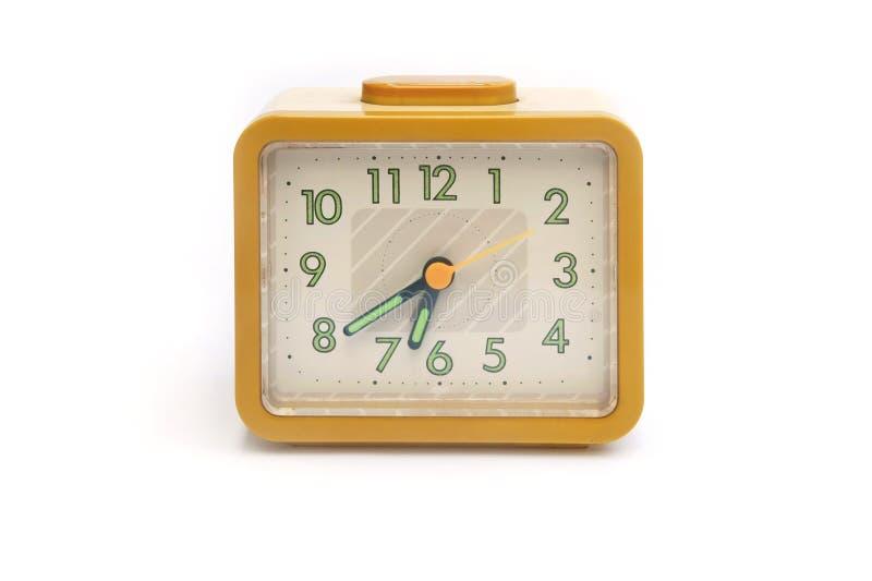 Ρολόι που απομονώνεται κίτρινο στοκ φωτογραφίες
