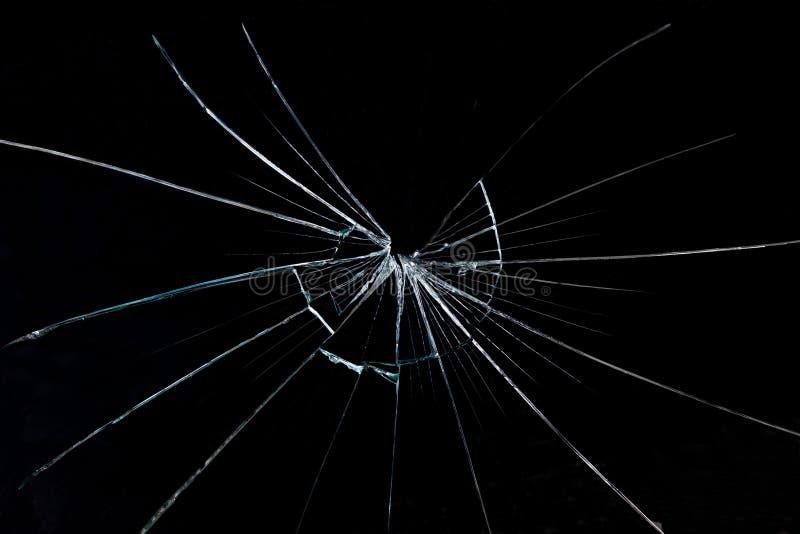 Ρωγμή στο γυαλί σε ένα μαύρο υπόβαθρο στοκ φωτογραφία
