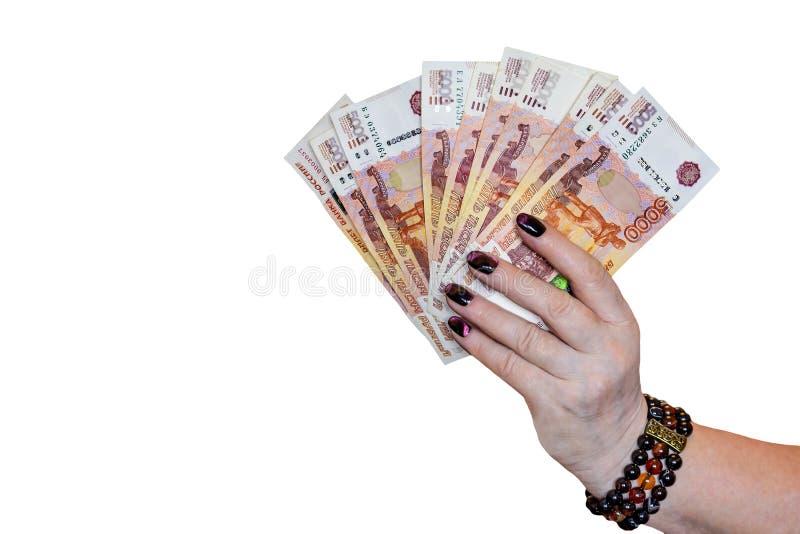 Ρωσικά χρήματα σε ένα καλά-καλλωπισμένο θηλυκό χέρι που αερίζεται έξω απομονωμένος σε ένα άσπρο υπόβαθρο στοκ εικόνες με δικαίωμα ελεύθερης χρήσης