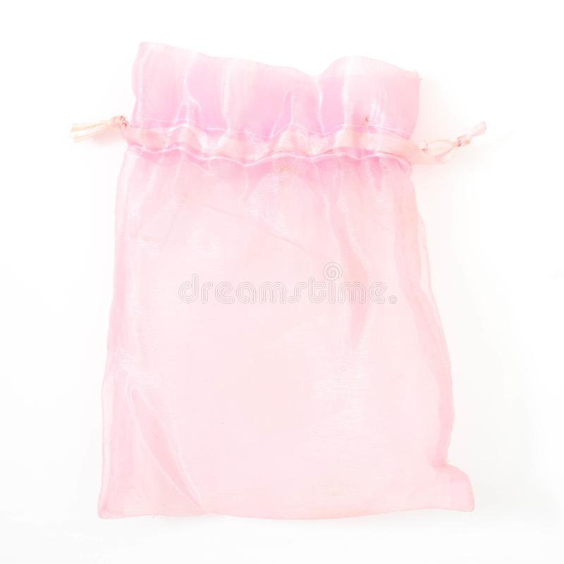 ρόδινη σακούλα μεταξιού για να κρατήσει το κόσμημα στοκ εικόνα με δικαίωμα ελεύθερης χρήσης