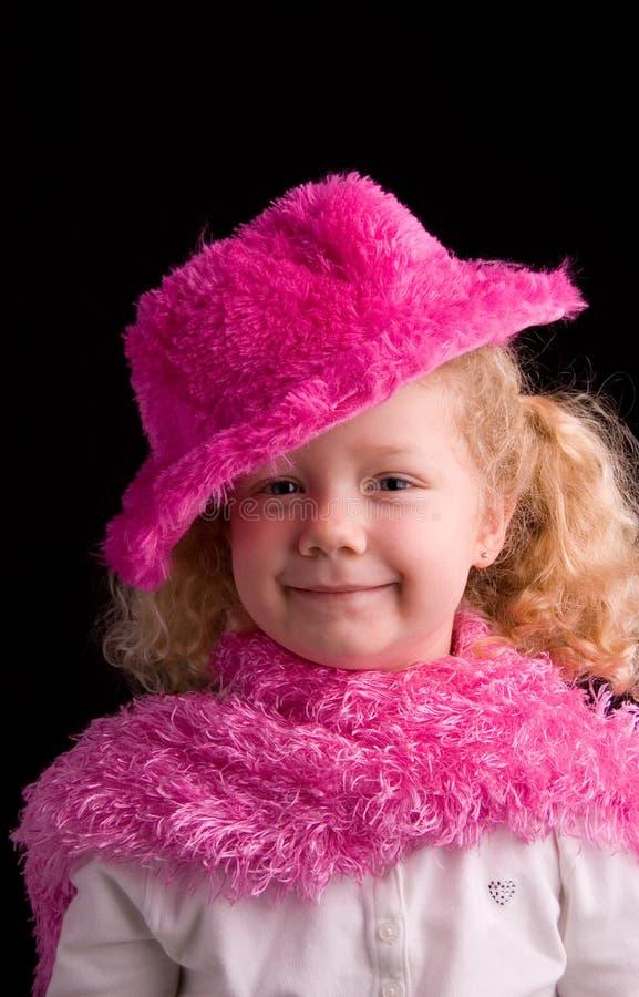 ρόδινο χαμόγελο καπέλων στοκ εικόνες