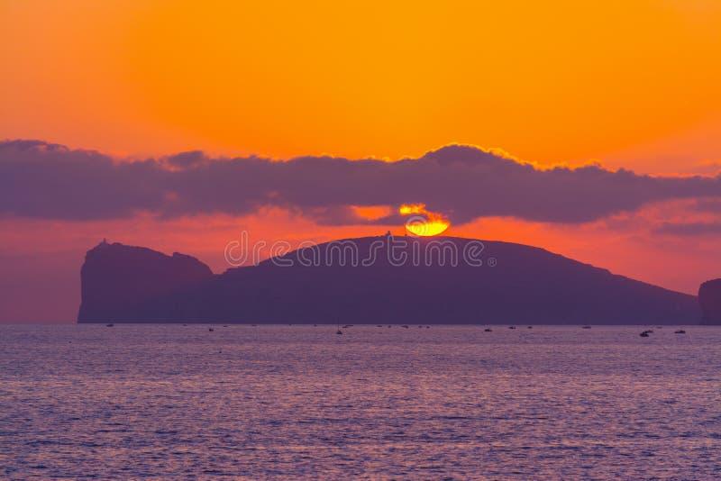 Ρόδινο ηλιοβασίλεμα σε Capo Caccia στοκ φωτογραφία