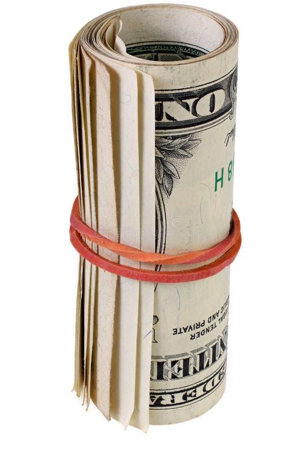 Ρόλος δολαρίων που σφίγγεται με τη λαστιχένια ζώνη Κυλημένα χρήματα που απομονώνονται στο λευκό στοκ εικόνες