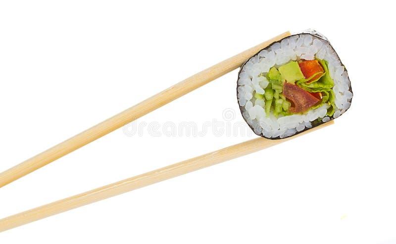 Ρόλος σουσιών με chopsticks που απομονώνονται στοκ εικόνα με δικαίωμα ελεύθερης χρήσης