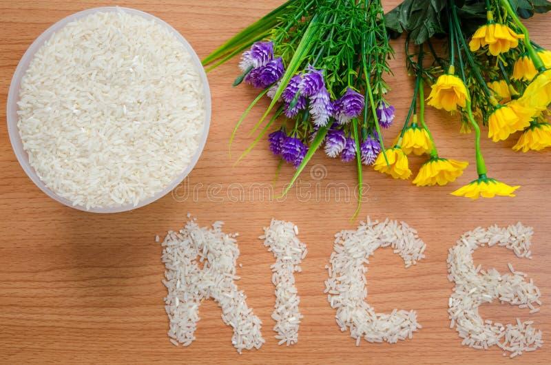 Ρύζι και λουλούδι με τη λέξη στοκ φωτογραφίες