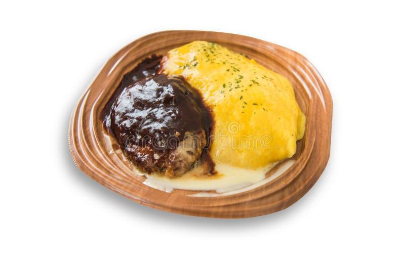 Ρύζι ομελετών με το πρόσθετο ύφος λάβας χάμπουργκερ βόειου κρέατος στοκ εικόνα με δικαίωμα ελεύθερης χρήσης