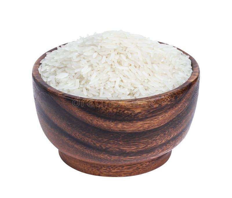 Ρύζι της Jasmine στο ξύλινο κύπελλο που απομονώνεται στο άσπρο υπόβαθρο στοκ εικόνες