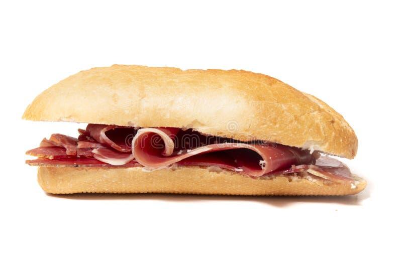 σάντουιτς με το καπνισμένο θεραπευμένο ζαμπόν στοκ εικόνα