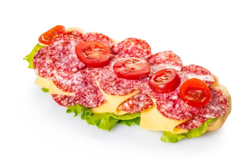 Σάντουιτς με το σαλάμι, το τυρί και τα λαχανικά στοκ εικόνες