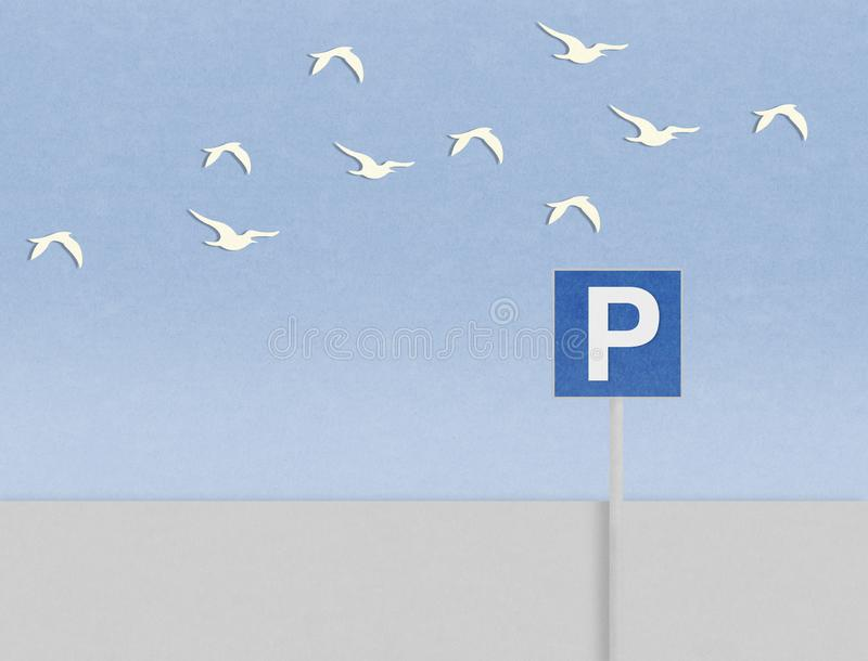 Σήμα και πουλιά χώρων στάθμευσης πίσω από την παραλία απεικόνιση αποθεμάτων