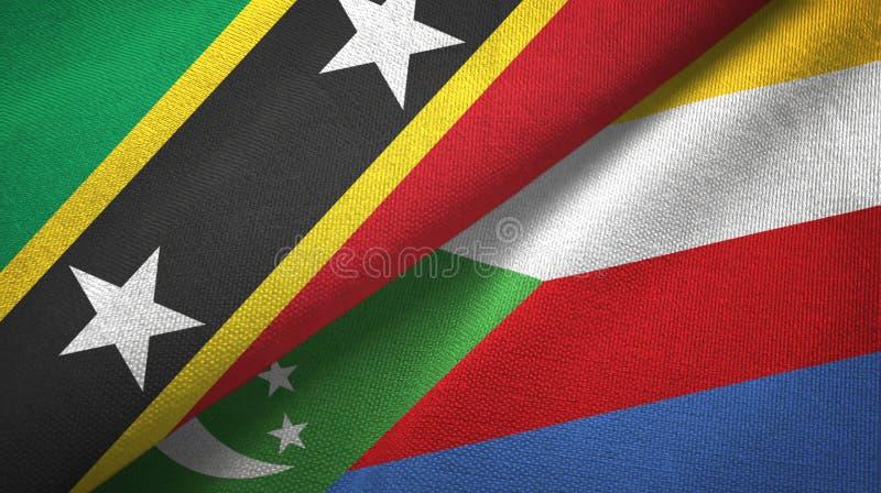 Σαιντ Κιτς και Νέβις και Κομόρες δύο υφαντικό ύφασμα σημαιών, σύσταση υφάσματος ελεύθερη απεικόνιση δικαιώματος